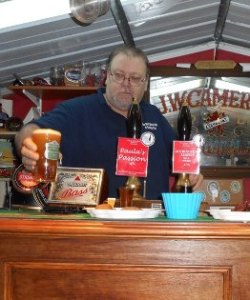 Big John serves the first pint of the night